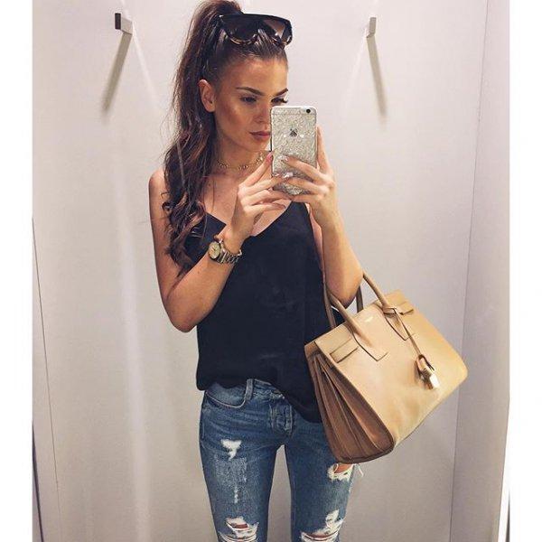 handbag, clothing, sleeve, hairstyle, outerwear,
